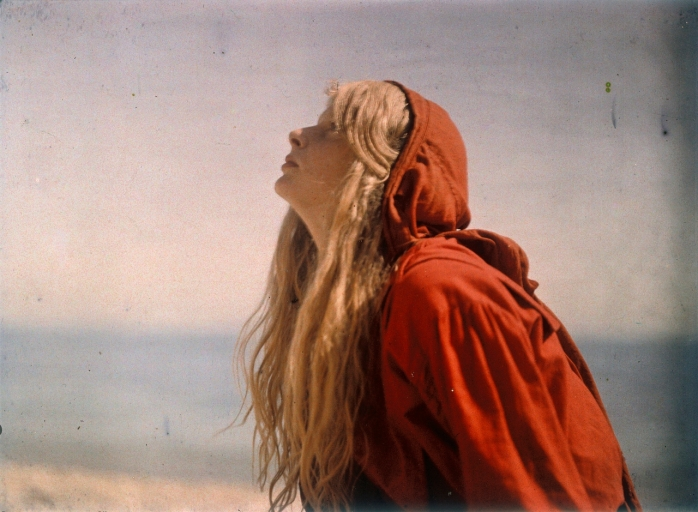 Portrait of Christina wearing a red cloak c.1913. Autochrome by Lieutenant Colonel Mervyn O'Gorman © Royal Photographic Society/ National Media Museum