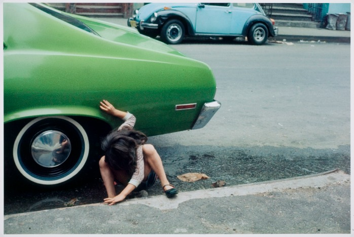 Helen Levitt - Girl playing under green car, New York City, 1980 - © Images copyright of the respective owners, assignees or others