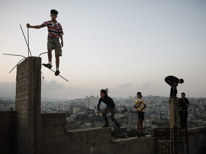 Christopher Anderson, Palestine. 2007. Boys playing on a hill overlooking Bethlehem - © Chrisopher Anderson